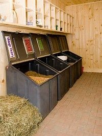 An organized feed room with supplement shelves, clean floor, pony-proof feed bins = healthy livestock Why did we never have this in the show barn?!??