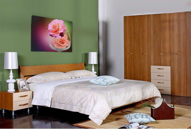 Bedroom in soothing colors. Big picture of roses revives the atmosphere.
