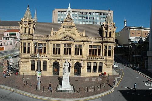 The splendid old Port Elizabeth Main Library is situated in the North-Western corner of Market Square. The first building on the site was constructed in 1835 and was initially used as a courthouse from 1854. The present library building was officially opened in 1902. The building is regarded as an excellent example of Victorian Gothic architecture and the terra-cotta façade was manufactured in England. The majestic Sicilian marble statue of Queen Victoria, keeps watch on the Market Square