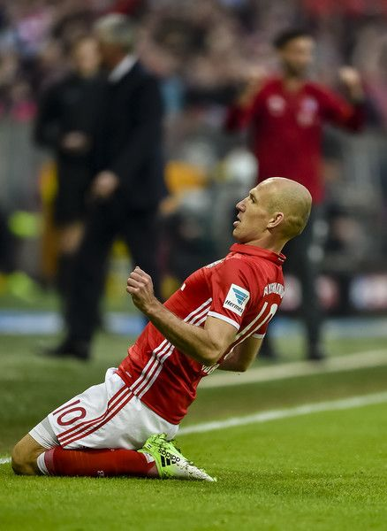 Bayern Munich's Dutch midfielder Arjen Robben celebrates scoring  during the German first division Bundesliga football match FC Bayern Munich v BVB Borussia Dortmund in Munich, southern Germany, on April 8, 2017. / AFP PHOTO / Guenter SCHIFFMANN / RESTRICTIONS: DURING MATCH TIME: DFL RULES TO LIMIT THE ONLINE USAGE TO 15 PICTURES PER MATCH AND FORBID IMAGE SEQUENCES TO SIMULATE VIDEO. == RESTRICTED TO EDITORIAL USE == FOR FURTHER QUERIES PLEASE CONTACT DFL DIRECTLY AT + 49 69 650050.
