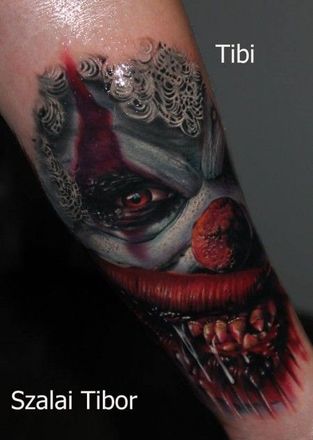 Cool idea of spooky clown tattoo on arm by Szalai Tibor