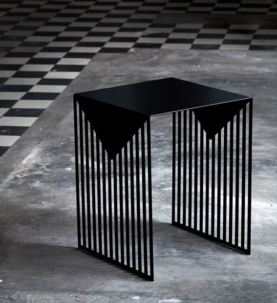 Each table design is laser-cut from a single sheet. The graphic nature of the negative spaces cut into the legs in light & shadow create varying geometric patterns depending on the viewer's position. The tables are shown in a powder coated matte black & low luster copper plated finishes.