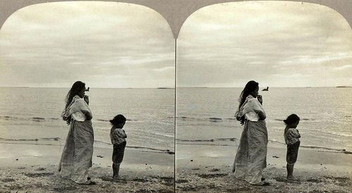 Philippine Woman and Child on the Shores of Manila Bay by Okinawa Soba, via Flickr. Is that the freakin Loch Ness Monster!!?!?!