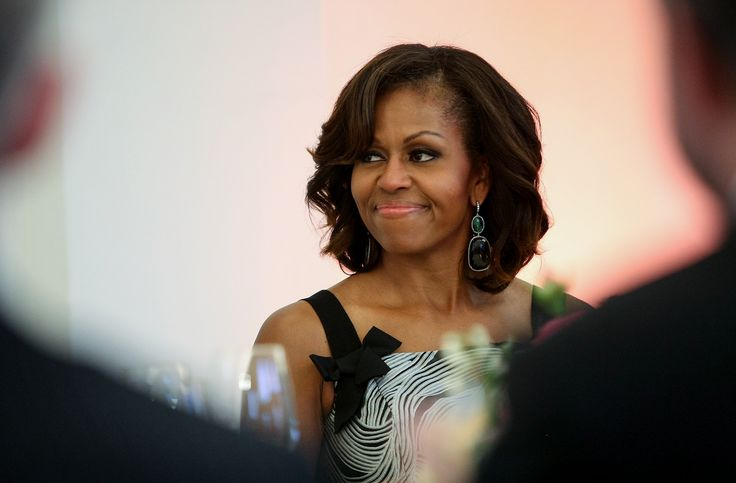 A West Virginia mayor resigned her post Tuesday following a backlash after she posted a response to a racist comment about first lady Michelle Obama on Facebook.