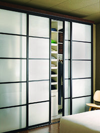 These closet doors are inspired by the design of traditional shoji screens. I love the clean design. I have been waiting ten years to get these doors for my house. Now I am ready to commit to three pairs of doors exactly like this image.Sliding Door Panels | Sliding Door Company