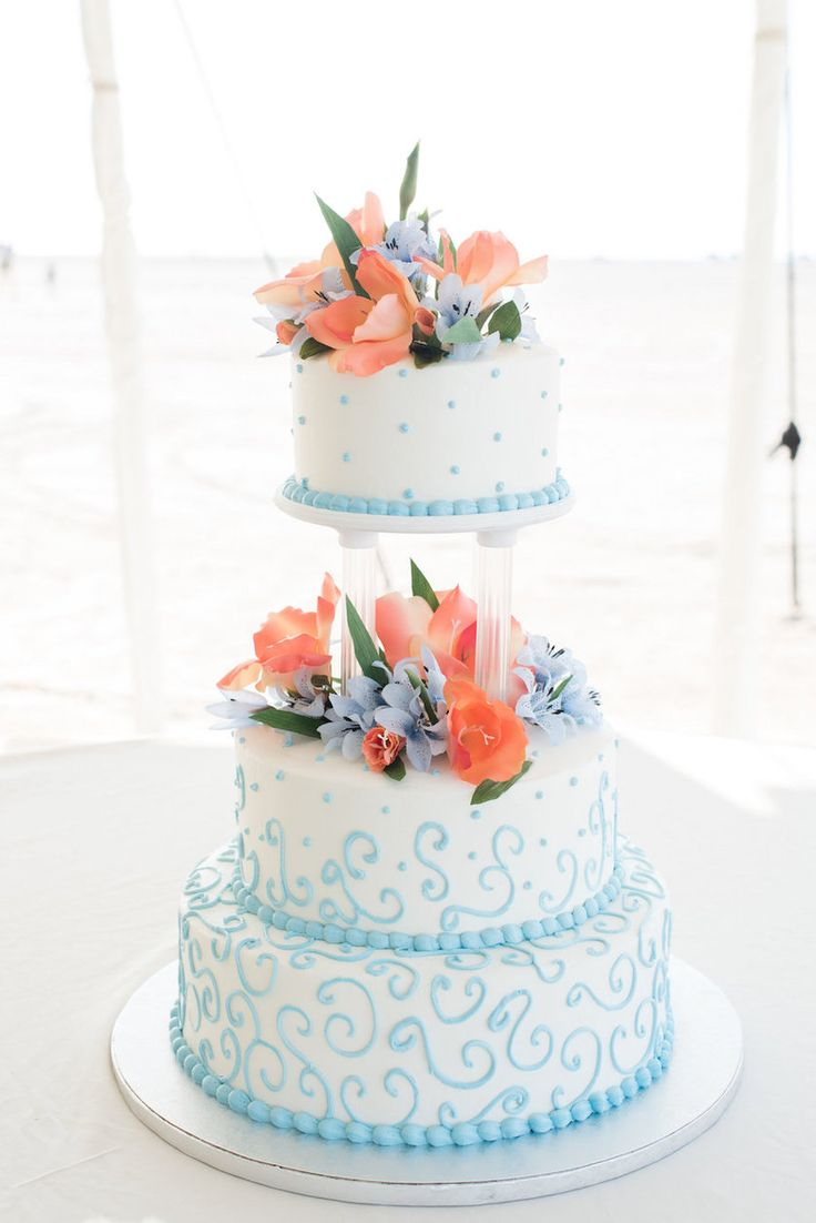Light Blue and White Tiered Wedding cake with Coral and Light Blue Floral Accents| Clearwater Wedding Photographer Caroline and Evan Photography