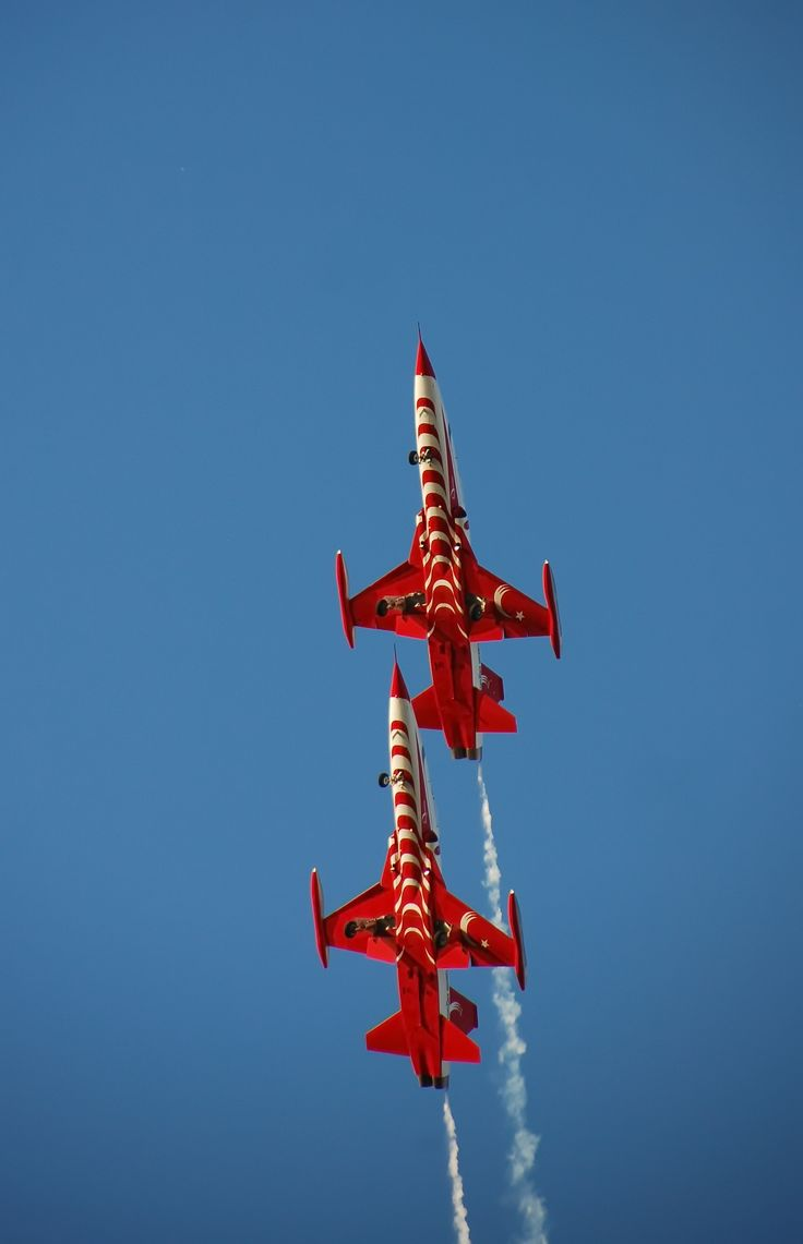 climbing vertical in very close formation ;turkish stars f5 planes during an air show