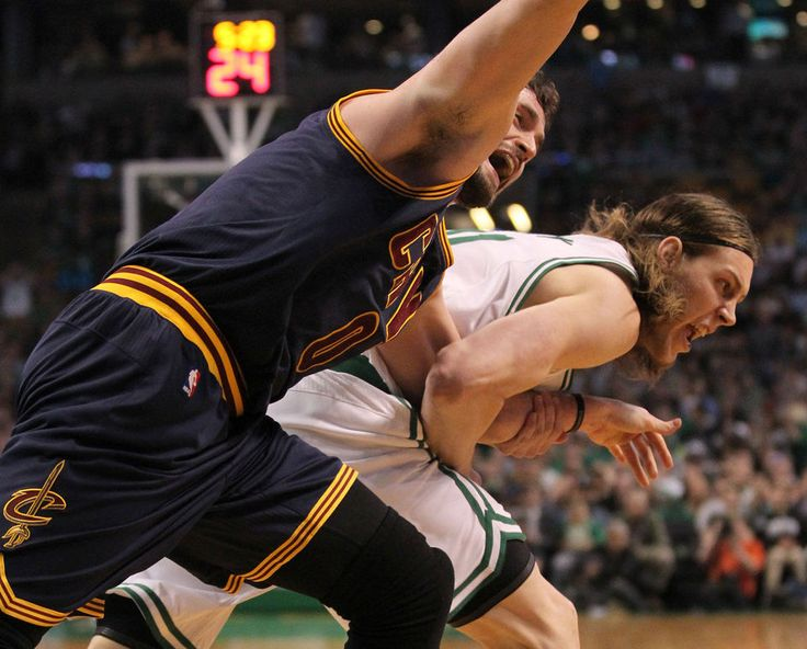Cleveland Cavaliers forward Kevin Love (0) is dragged by the arm by Boston Celtics center Kelly Olynyk (41), resulting in an injury to Love that forced him from the game.  TD Garden on Sunday, April 26, 2015. (Thomas Ondrey/The Plain Dealer)