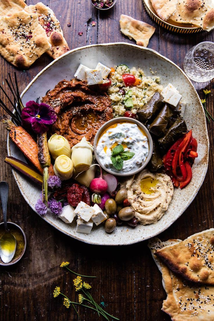 Middle Eastern Roasted Red Pepper Meze Platter - Muhammara, hummus, tzatziki, tabbouleh, feta, stuffed grape leaves, veggies and naan. @halfbakedharvest.com