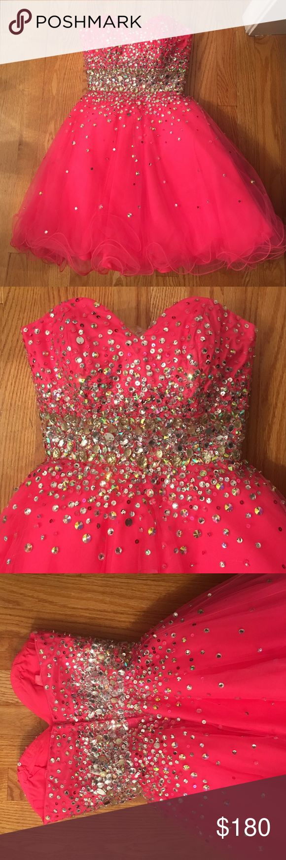 Mori Lee Short Neon Pink Dress Mori Lee Short Neon Pink Dress for proms/sweet 16/etc. Size 2. worn once and it perfect condition with all beads in place. never altered. Mori Lee Dresses Prom