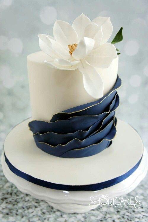 Navy ruffles on this elegant wedding cake