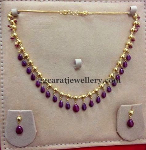 22 carat gold very simple yet elegant choker necklace for kids and all ages. Purple color ruby drops hanging all over the set and it carr...