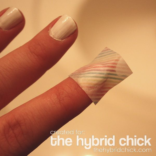 Rubbing alcohol and scrapbook paper, it transfers the designs onto your nails! I MUST try this!!!