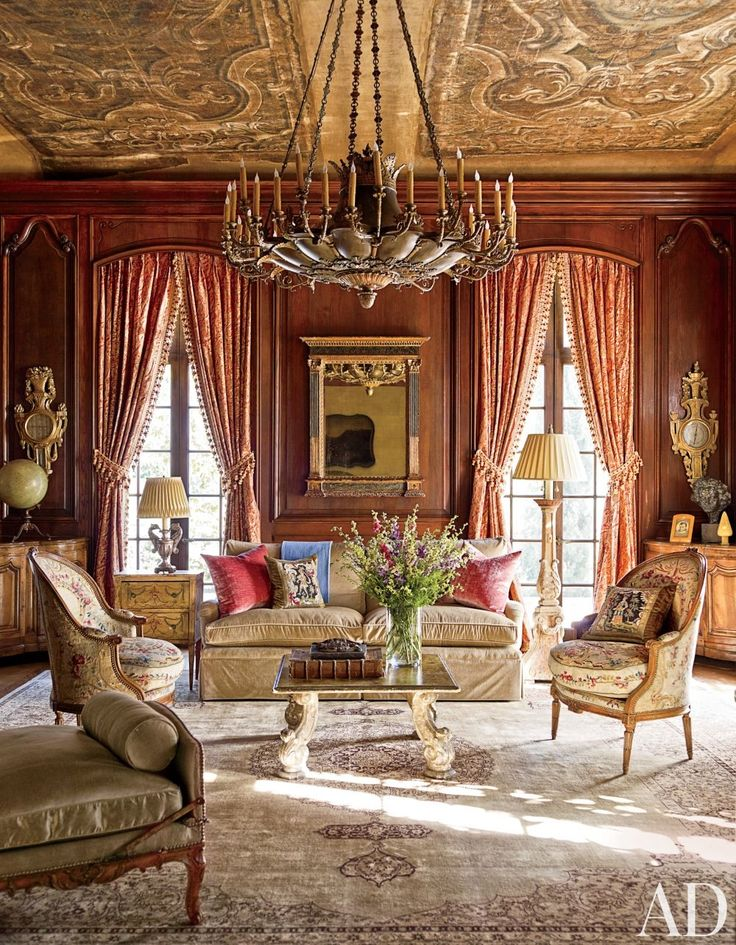 French rich style, colonial library with enormous chandelier, Persian rug, and antique furniture. Love the heavy drapery!
