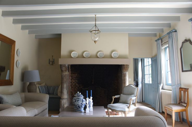 """Complete redecoration for this country retreat on the Normandy Coast, which inspired the soft palette of sand and sky blue. The walls are painted in Farrow  Ball's """"Matchstick"""", while the beams are in """"Light Blue"""" and the other paintwork is in """"Oval Room Blue""""."""