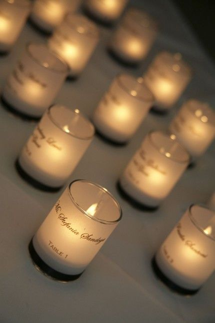 printed vellum wrapped votive candle as escort card