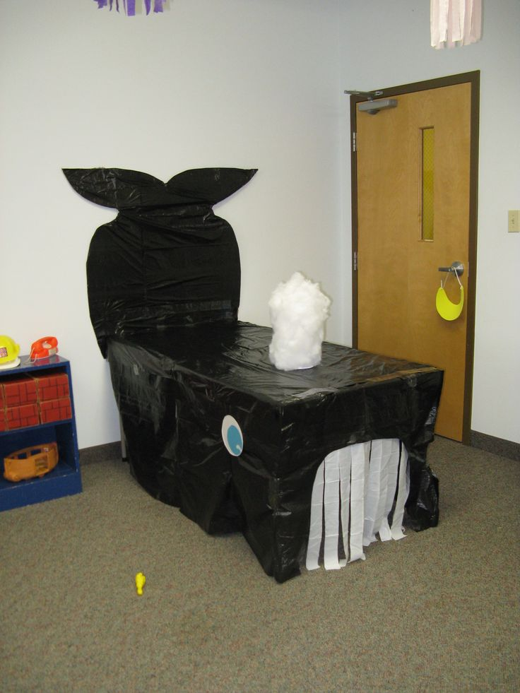 This was a whale for Jonah....could be for an under the sea theme also. Made with two card tables, garbage bags, eye was a plate, tail was a garbage bag covered piece of cardboard. The mouth was a white kitchen garbage bag cut in strips, the blowhole was cotton batting around an oatmeal container. Lots of fun! :0)