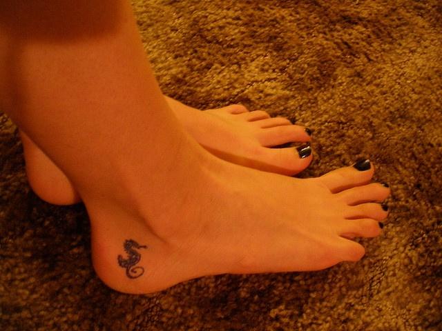 Cute seahorse tattoo.