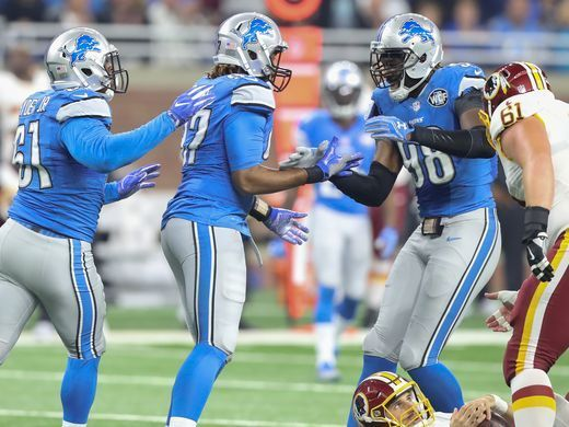 Redskins vs. Lions;   -   October 23, 2016  -  20-17, Lions  -     Lions defensive lineman Armonty Bryant, center, celebrates with teammates Kerry Hyder, left, and Devin Taylor after sacking the Washington Redskins' Kirk Cousins (on the ground) during the first half Sunday, Oct. 23, 2016 at Ford Field in Detroit.  Kirthmon F. Dozier, DFP