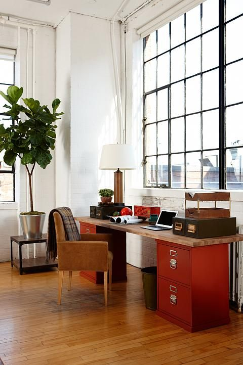 A simple office space. You don't need a traditional desk. Take two filing cabinets and a slab of wood stained in the color of your choice and you've got yourself a really cool desk.