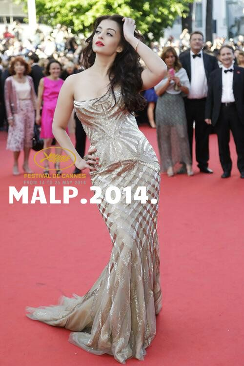 Aishwarya Rai Bachchan is seen here walking the red carpet at the premiere of the movie 'Deux Jours, Une Nuit'. Dressed in a strapless Cavalli gown, Aishwarya looked gorgeous as always, at the 67th Cannes International Film Festival.