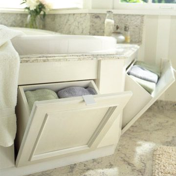 Tub-Surround Storage - Acquire hidden space in a tub surround with a tilt-out bin and a recessed-panel door. Use these cubbies to store towels, shampoo, conditioner, bubble bath, and other bathtime needs.