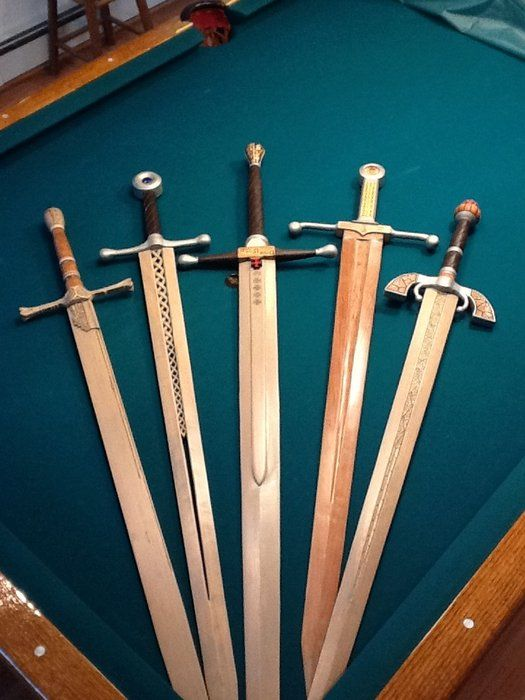 Holy cow!  Check out these wood fantasy and medieval swords!