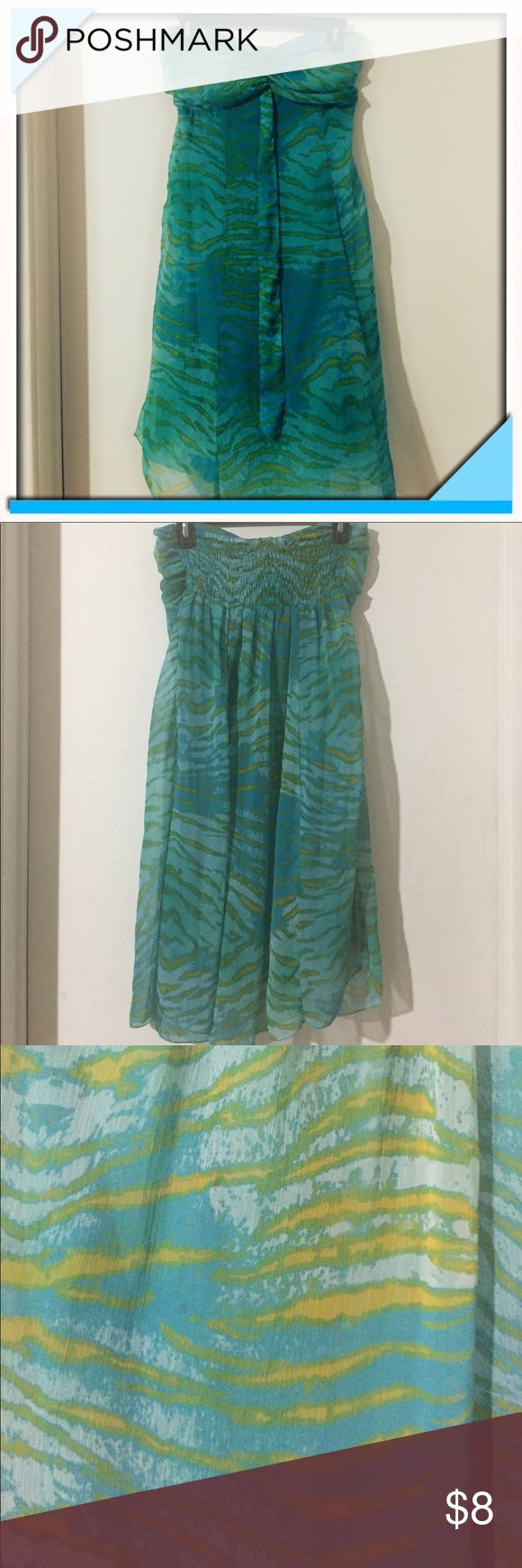 Strapless Blue and Green Beach Dress Strapless dress, very oceany look: blue and green. Dress is sheer with a built in aqua slip underneath. Dress is very stretchy, a one size fits most kind of deal. Lightly used, no defects, in excellent condition. Made of 100% polyester. India Boutique Dresses Strapless