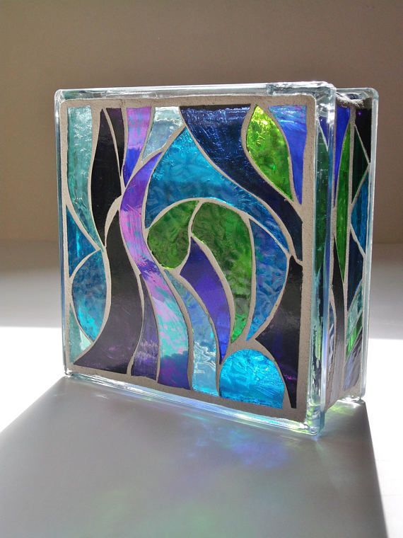 A brilliant stained glass light to enjoy in two different patterns. Done in shades of greens, blues, purples, and a pale green textured glass. The colors in the sunlight are more realistic than the photo with the lights in it. It really is green and not yellow as it looks at times in #StainedGlassLight