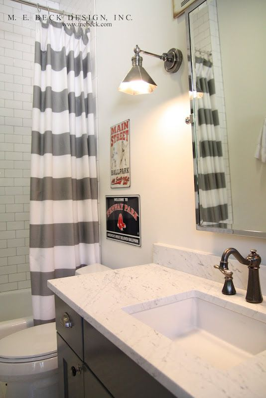 Baths for boys don't need to sacrifice style! This teen boy's bathroom uses an industrial sconce and the Pfister Marielle Widespread Lavatory Faucet in Rustic Pewter for a masculine look.