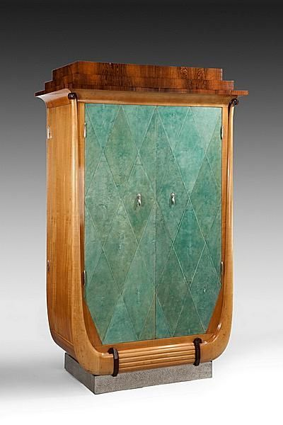 An Art Deco dressing cabinet in sycamore and rosewood. Shagreen covered doors. French, circa 1920.