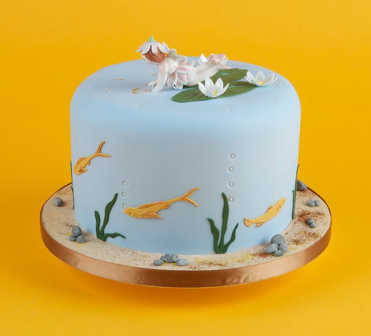 This fun cake features our Waterlily / Fish Set. The flower fairy has been made free hand but is dressed in beautiful daisies from our Daisy Stencil & Cutter pack.