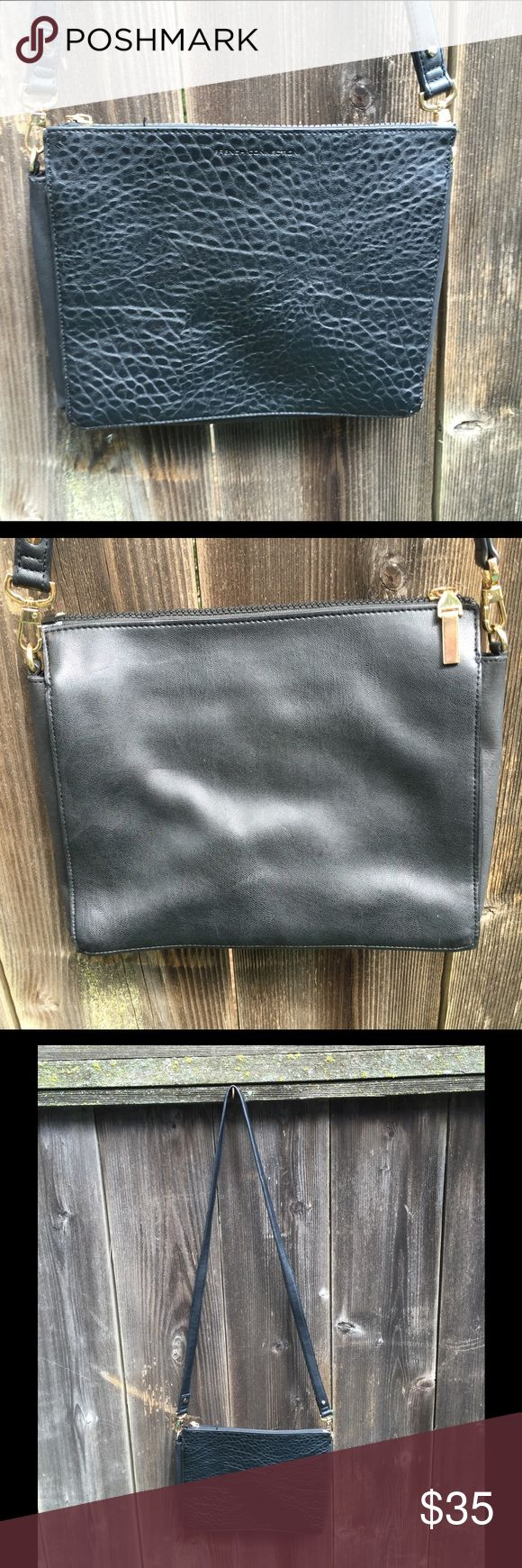 Black French Connection purse Black French Connection purse- can be worn over the shoulder or cross body. One side is a flat, smooth leather the other is a cool texture. Like new condition! French Connection Bags Crossbody Bags