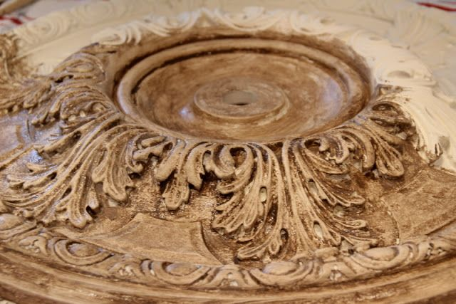 Gorgeous tutorial!  How to paint a plain ceiling medallion to look like aged stone.  Fantastic!