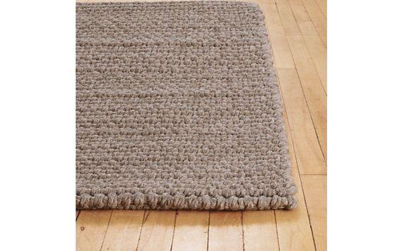 Thatch rug in mushroom for TV room