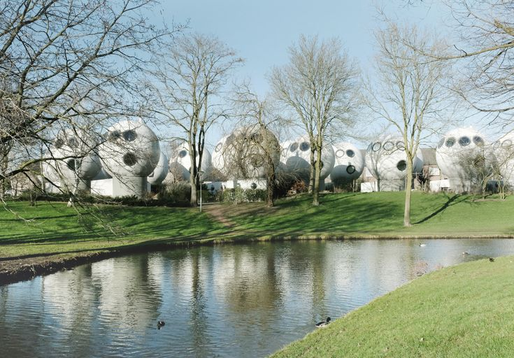 Built by Dries Kreijkamp  in 's-Hertogenbosch, The Netherlands with date 1984. Images by Gili Merin. In the quaint Dutch town of Den Bosch, amongst typical brick-clad homes and winding canals, sits the odd community of...
