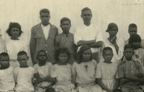 """Children seated and standing in rows: """"Stolen Generation Children Kahlin Compound"""", Northern Territory Library, Peter Spillett Collection, published 1921"""