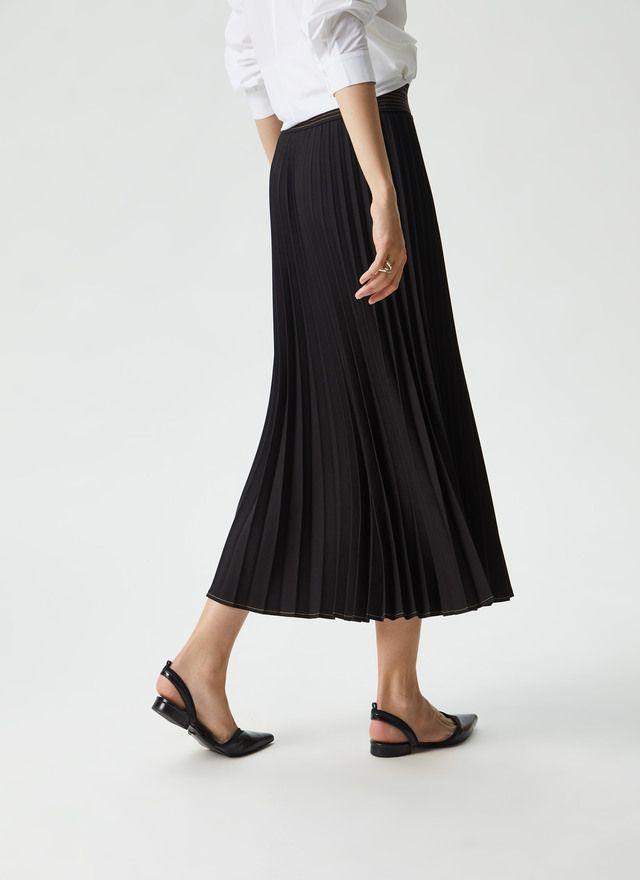 e8e0d90f97 Falda plisada con pespuntes en cintura Negro