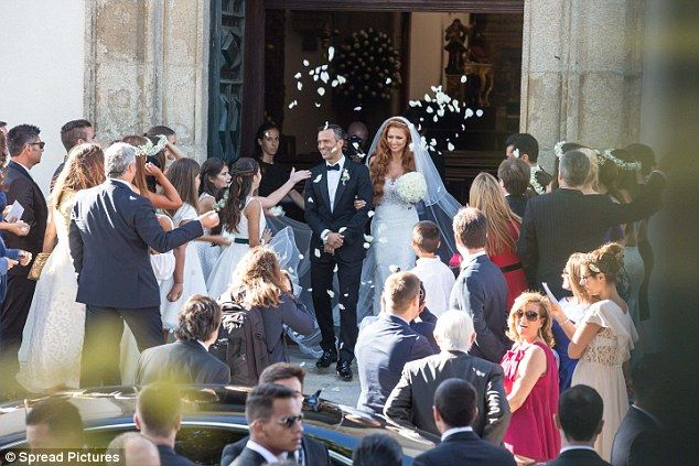 Confetti is thrown outside the Sao Joao Baptista church in Porto as well wishers greet the...