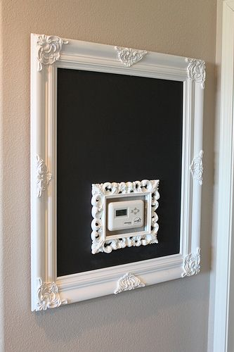 Hate to loose an entire wall due to thermostat.  Great chalk board idea.