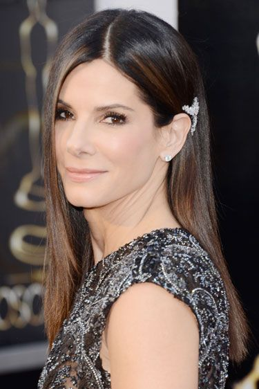 Sandra Bullock  While we loved Sandra Bullock's no-fuss, sleek and simple 'do and minimal makeup, we couldn't keep our eyes off her strategically placed above-the-ear hair clip.