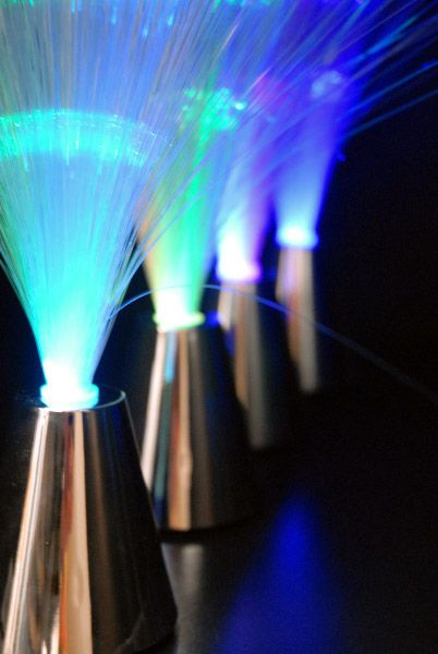 Fiber Optic Centerpieces (program to color ) $3 each  10 for $2.50 each. Cool, may be better for an event than our wedding.