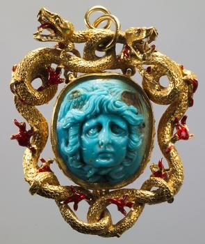 Cameo: Head of Medusa  Roman, Empire  First - 2nd Century AD  Turquoise glass. Frame: Gold, enamelled. Italian, mid-16th Century.