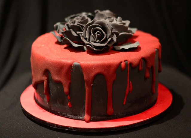 Gothic cake with black roses and dripping blood