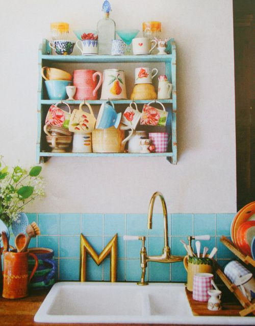 Brighten up your kitchen with a colorful collection of coffee mugs and open shelves.