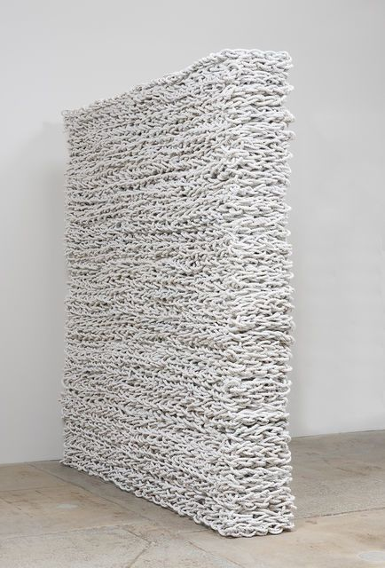 White spiral roped wall installation by Orly Genger.