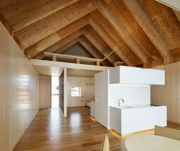 A collaboration between architect Shigeru Ban and housing-and-building-materials firm Lixil, this dwelling features innovative systems like integrated overhead clusters for water supply and wastewater removal and movable and rotating windows and glass walls, all of which allow for greater flexibility of layout.