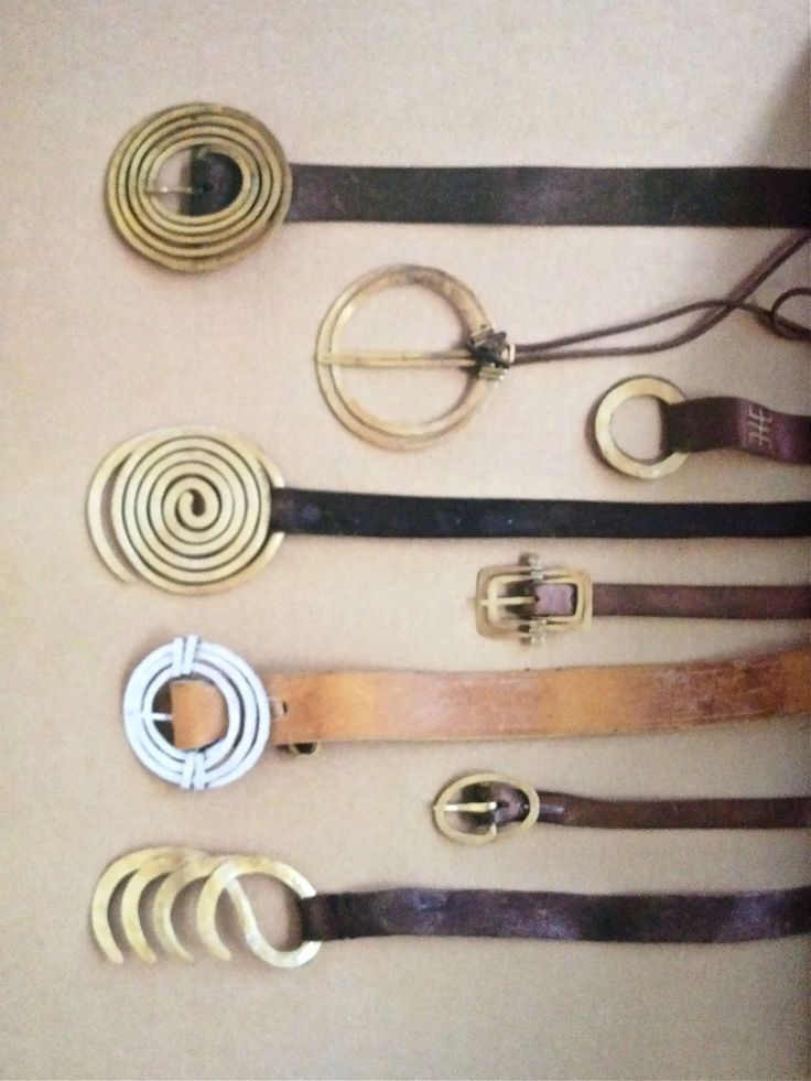 Alexander Calder Belt Buckles. make it yourself. leather cord and two light weight brass/copper rings.