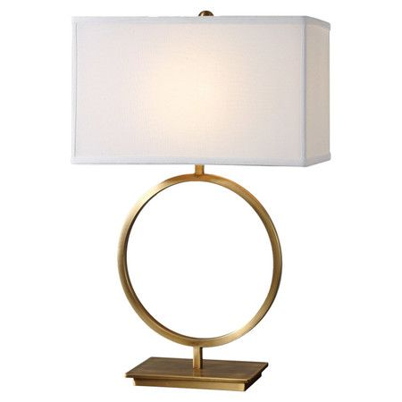Add a pop of contemporary-chic style to your living room or parlor with this hand-forged metal lamp, showcasing an openwork base and brushed brass finish.