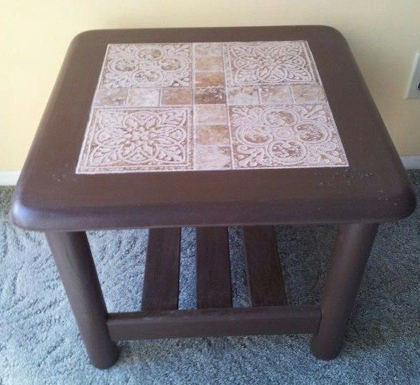 Start with an old glass top end table. Take out the glass and paint the wood a darker color.  Put a piece of plywood under the place where the glass used to be, then  add tile to the top and grout. It looks like an expensive new end table!